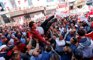 A member of the Tunisian General Labour Union (UGTT) is thrown into the air by his colleagues during a rally to mark International Workers' Day, or Labour Day, in Tunis, Tunisia. REUTERS/Zoubeir Souissi